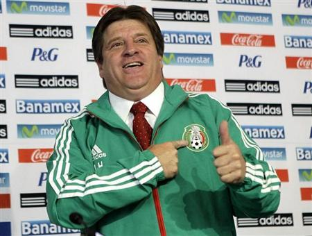 Mexico's new national soccer team coach Miguel Herrera poses during his presentation to the media in Mexico City October 20, 2013. REUTERS/Henry Romero
