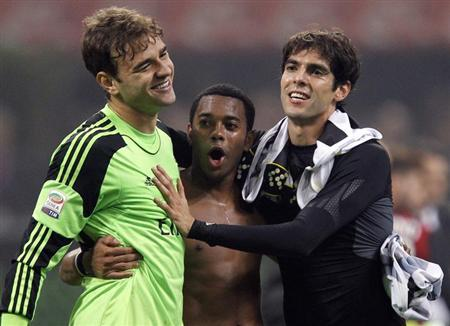 (L-R) AC Milan's Gabriel, Robinho and Kaka celebrate their win at the end of their Italian Serie A soccer match against Udinese at the San Siro stadium in Milan October 19, 2013. REUTERS/Alessandro Garofalo