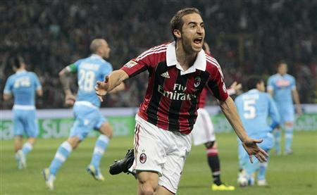 AC Milan's Mathieu Flamini celebrates after scoring against Napoli during their Italian Serie A soccer match at the San Siro stadium in Milan April 14, 2013. REUTERS/Alessandro Garofalo