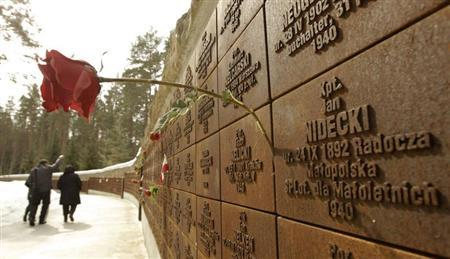 A flower is attached to a wall inscribed with the names of killed Polish officers during a commemoration ceremony at a memorial complex in Katyn, about 350 km (217 miles) west of Moscow, April 10, 2013. REUTERS/Vasily Fedosenko