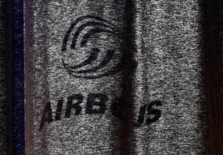 The shadow of an Airbus logo is cast on a curtain in Finkenwerder near Hamburg in this October 30, 2009 file photo. REUTERS/Christian Charisius/Files