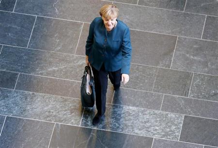 German Chancellor and leader of the Christian Democratic Union (CDU) Angela Merkel arrives for a meeting of senior party leaders before preliminary talks between Germany's conservative (CDU/CSU) parties and the Social Democrats (SPD) in Berlin October 4, 2013. REUTERS/Fabrizio Bensch