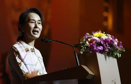 Myanmar's opposition leader Aung San Suu Kyi speaks to the Myanmar community living in Singapore on the island of Sentosa in Singapore September 22, 2013. REUTERS/Edgar Su