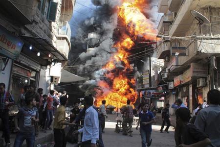 Residents run from a fire at a gasoline and oil shop in Aleppo's Bustan Al-Qasr neighbourhood October 20, 2013. REUTERS/Haleem Al-Halabi