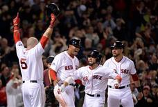 Oct 19, 2013; Boston, MA, USA; Boston Red Sox right fielder Shane Victorino (middle) celebrates with teammates including Jonny Gomes (5) after hitting a grand slam against the Detroit Tigers during the seventh inning in game six of the American League Championship Series playoff baseball game at Fenway Park. Robert Deutsch-USA TODAY Sports