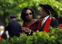 Media mogul Oprah Winfrey and professor Henry Louis Gates Jr. (R) arrive for Harvard University's 362nd Commencement Exercises in Cambridge, Massachusetts in this May 30, 2013, file photo. REUTERS/Brian Snyder/Files