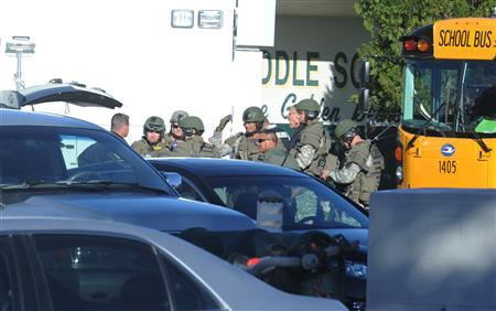 Police officers are at the shooting scene at the Sparks Middle School in Sparks, Nevada, October 21, 2013. REUTERS/Marilyn Newton/Reno Gazette-Journal