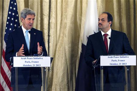 U.S. Secretary of State John Kerry (L) and Qatar's Foreign Minister Khalid bin Mohamed al-Attiyah (R) attend a news conference at the U.S. Ambassador residence in Paris October 21, 2013 after a meeting with the Arab League in Paris. REUTERS/Charles Platiau