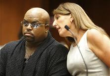 "Grammy Award winning R&B singer and ""The Voice"" TV judge CeeLo Green (L), confers with attorney Blair Berk in Clara Shortridge Foltz Criminal Justice Center in Los Angeles, California October 21, 2013. REUTERS/Mel Melcon/The Los Angeles Times/Pool"
