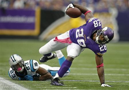 Oct 13, 2013; Minneapolis, MN, USA; Minnesota Vikings running back Adrian Peterson (28) breaks the tackle of Carolina Panthers cornerback Melvin White (23) in the second quarter at Mall of America Field at H.H.H. Metrodome. Panthers win 35-10. Mandatory Credit: Bruce Kluckhohn-USA TODAY Sports