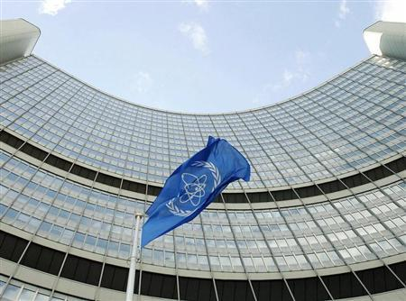 The flag of the International Atomic Energy Agency (IAEA) flies in front of the Vienna headquarters, in this file photograph taken August 9, 2005.