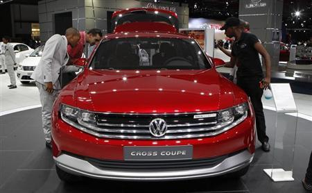 Visitors look at Volkswagen's Cross Coupe during the media preview of the Johannesburg International Motor Show, in Johannesburg October 17, 2013. The show runs until October 27. REUTERS/Siphiwe Sibeko