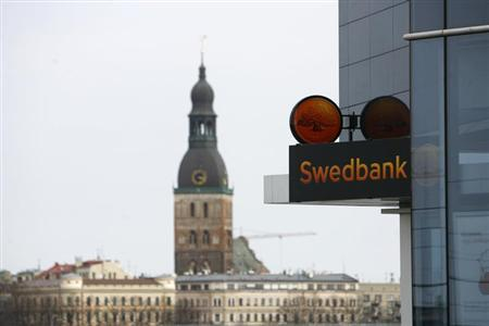 The logo of Swedbank is seen at its Latvia branch main office in Riga in this April 23, 2009 file photo. REUTERS/Ints Kalnins/Files