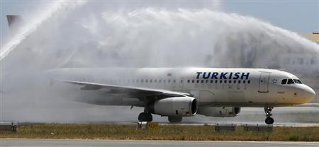 A Turkish Airlines Airbus A320 aircraft is welcomed to Malta by a water arch at Malta International Airport outside Valletta May 25, 2013. REUTERS/Darrin Zammit Lupi