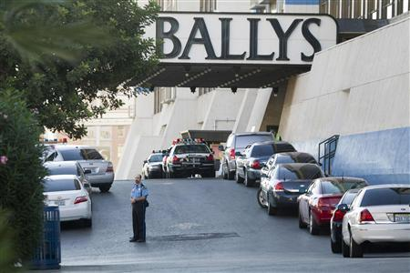 Metro Police cars and a hotel security officer are seen in front of Bally's hotel-casino after an early morning shooting left one person dead and two wounded in Drai's, a nightclub inside Bally's, in Las Vegas, Nevada, October 21, 2013. A suspect is in custody, police said. REUTERS/Las Vegas Sun/Steve Marcus
