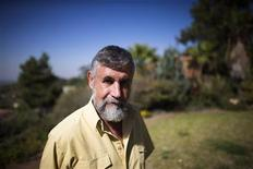 Retired Israeli spy Mishka Ben-David poses for a picture outside his home in Ramat Raziel near Jerusalem October 22, 2013. REUTERS/Ronen Zvulun