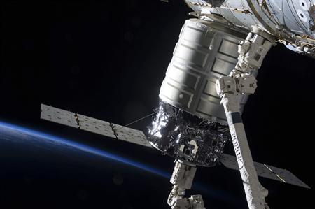 Attached to the Harmony node, the first Cygnus commercial cargo spacecraft built by Orbital Sciences Corp., in the grasp of the Canadarm2, is photographed by an Expedition 37 crew member on the International Space Station, in this handout photo courtesy of NASA, released October 5, 2013. REUTERS/NASA/Handout via Reuters