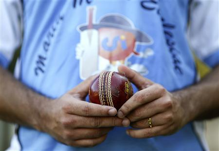 A player from a team of priests and seminarians holds a cricket ball during a training session at the Maria Mater Ecclesiae's Catholic College in Rome October 22, 2013. REUTERS/Alessandro Bianchi