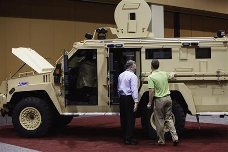Attendees look at the Lenco MRAP Bear SWAT Team vehicle at the 7th annual Border Security Expo in Phoenix, Arizona March 12, 2013. REUTERS/Joshua Lott