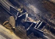 Investigators survey the site of a train derailment near the hamlet of Gainford, west of Edmonton October 20, 2013. REUTERS/Dan Riedlhuber