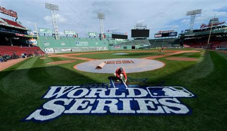 Oct 22, 2013; Boston, MA, USA; Chris Williams paints the World Series logo on the field during media day the day before game one of the 2013 World Series between the Boston Red Sox and St. Louis Cardinals at Fenway Park. Mandatory Credit: Robert Deutsch-USA TODAY Sports
