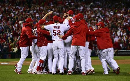 Oct 18, 2013; St. Louis, MO, USA; Members of the St. Louis Cardinals including Michael Wacha (52) celebrate on the field after game six of the National League Championship Series baseball game against the Los Angeles Dodgers at Busch Stadium. Scott Rovak-USA TODAY Sports
