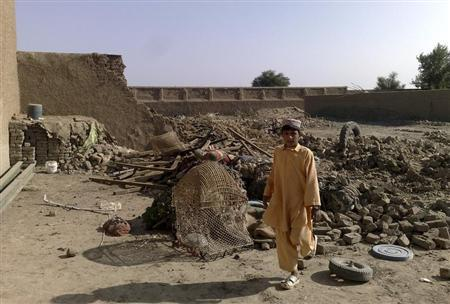 A boy stands at the site of suspected U.S. drone attacks in the Janikhel tribal area in Bannu district of North West Frontier Province November 19, 2008. REUTERS/Stringer