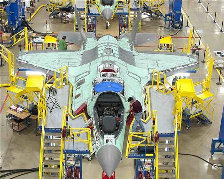 Workers can be seen on the moving line and forward fuselage assembly areas for the F-35 Joint Strike Fighter at Lockheed Martin Corp's factory located in Fort Worth, Texas in this October 13, 2011 file handout photo. REUTERS/Lockheed Martin/Randy A. Crites/Handout