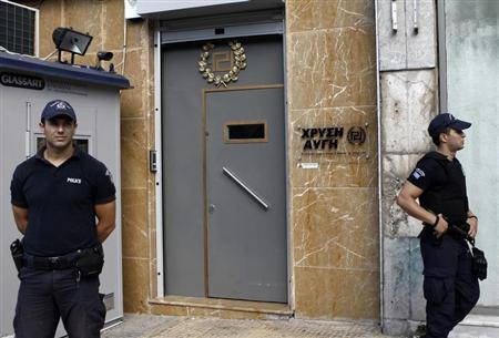 Police officers stand guard outside the headquarters of the Golden Dawn far-right party in Athens September 18, 2013. REUTERS/John Kolesidis