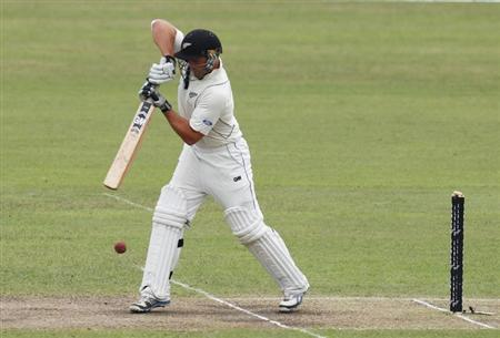 New Zealand's Corey Anderson plays a ball against Bangladesh, during their third day of second test cricket match of the series in Dhaka October 23, 2013. REUTERS/Andrew Biraj