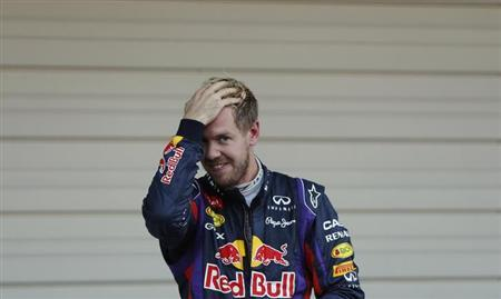 Red Bull Formula One driver Sebastian Vettel of Germany reacts after winning the Japanese F1 Grand Prix at the Suzuka circuit October 13, 2013. REUTERS/Issei Kato