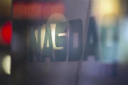 A logo is seen on a window outside of the Nasdaq MarketSite building in New York's Times Square, August 22, 2013. REUTERS/Lucas Jackson