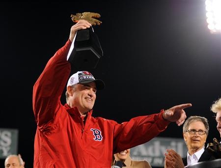 Boston Red Sox manager John Farrell holds the American League championship trophy after defeating the Detroit Tigers in game six of the American League Championship Series playoff baseball game at Fenway Park. Mandatory Credit: Robert Deutsch-USA TODAY Sports