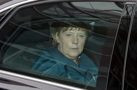German Chancellor and leader of the Christian Democratic Union (CDU) Angela Merkel sits in her limousine as she leaves the first round of coalition talks between Germany's conservative (CDU/CSU) parties and the Social Democratic Party (SPD) in Berlin October 23, 2013. REUTERS/Fabrizio Bensch