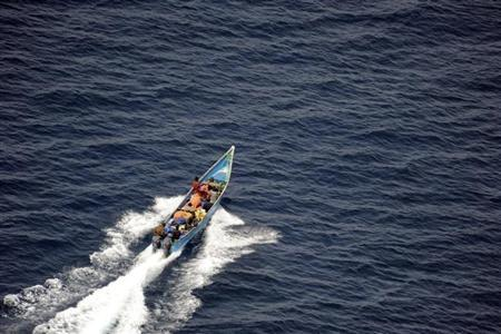 Pirates are boating before German navy from frigate Rheinland-Pfalz intercepted them in the Gulf of Aden off Somalia's coast on March 3, 2009, in this picture made available on March 4, 2009. REUTERS/Bundeswehr