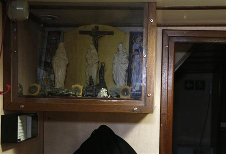 Religious icons are displayed aboard the Boulogne sur Mer based trawler 'Nicolas Jeremy' off the coast of northern France October 21, 2013. REUTERS-Pascal Rossignol