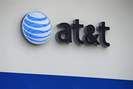 The AT&T logo is pictured by its store in Carlsbad, California, April 22, 2013. REUTERS/Mike Blake