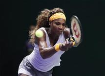 Serena Williams of the U.S. hits a return to Agnieszka Radwanska of Poland during their WTA tennis championships match at Sinan Erdem Dome in Istanbul October 23, 2013. REUTERS/Osman Orsal
