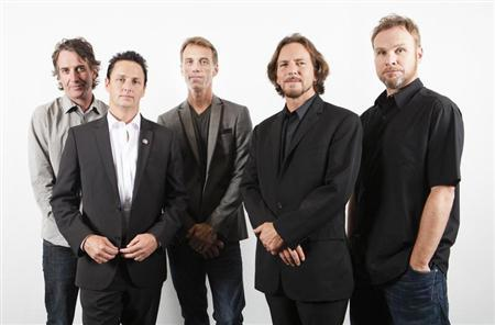 Members of the band Pearl Jam (L-R), Stone Gossard, Mike McCready, Matt Cameron, Eddie Vedder, and Jeff Ament of the film ''Pearl Jam Twenty'' pose during the 36th Toronto International Film Festival (TIFF) in Toronto, September 10, 2011. REUTERS/Mark Blinch