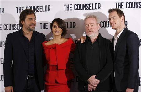 (L-R) Actors Javier Bardem and Penelope Cruz, Director Ridley Scott and actor Michael Fassbender pose for photographers at a photocall for the film ''The Counselor'' in London October 5, 2013. REUTERS/Olivia Harris