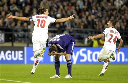 Paris Saint-Germain's Zlatan Ibrahimovic (L) react with Marco Verratti (R) after scoring a hattrick against Anderlecht during their Champions League soccer match at Constant Vanden Stock stadium in Brussels October 23, 2013. REUTERS/Laurent Dubrule