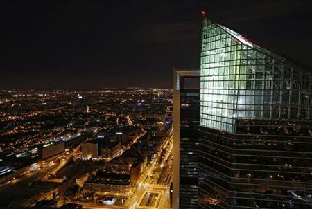 A view of the capital city pictured at dusk from 'Torre Espacio', at the Four Towers business district in Madrid June 10, 2013. Picture taken June 10, 2013. REUTERS/Rocio Pelaez
