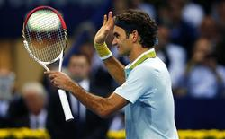 Switzerland's Roger Federer reacts after winning his match against Adrian Mannarino of France at the Swiss Indoors ATP tennis tournament in Basel October 21, 2013. REUTERS/Arnd Wiegmann