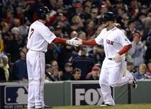 Oct 23, 2013; Boston, MA, USA; Boston Red Sox pinch hitter Daniel Nava (right) is congratulated by shortstop Stephen Drew (not pictured) after scoring a run in the 8th inning against the St. Louis Cardinals during game one of the MLB baseball World Series at Fenway Park. Robert Deutsch-USA TODAY Sports