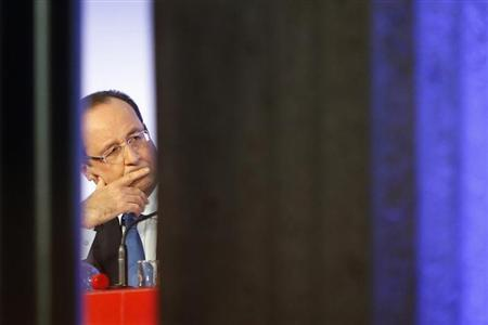 France's President Francois Hollande listens to a speech during a meeting called ''Reporters of Hopes, Solutions for France'' at Iena Palace in Paris October 18, 2013. REUTERS/Francois Mori/Pool