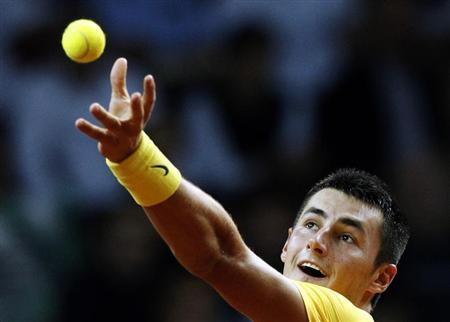 Australia's Bernard Tomic serves the ball to Poland's Lukasz Kubot during their Davis Cup play-off tennis match in Warsaw September 15, 2013. REUTERS/Kacper Pempel