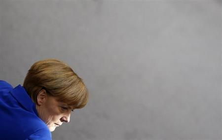 German Chancellor and leader of the Christian Democratic Union (CDU) Angela Merkel listens during a constitutional meeting of the Bundestag, Germany's lower house of parliament, in Berlin, October 22, 2013. REUTERS/Pawel Kopczynski