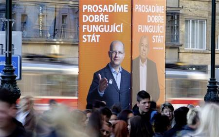 Pedestrians walk past a giant pre-election posters of Czech Social Democratic Party (CSSD) leaders, Bohuslav Sobotka (L) and Jaroslav Zahradil, in Prague October 1, 2013. The Czech Republic will hold an early election on October 25-26. The poster reads: ''We will enforce a well functioning state''. REUTERS/David W Cerny