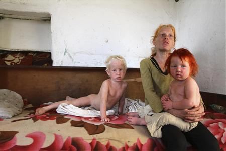 The children of Roma woman Sasha Ruseva, 38, (not pictured) rest inside their home in Nikolaevo, southern Bulgaria October 24, 2013. REUTERS/Stringer