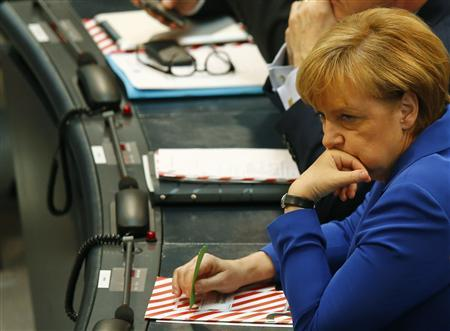 German Chancellor and leader of the Christian Democratic Union (CDU) Angela Merkel waits for the start a constitutional meeting of the Bundestag, Germany's lower house of parliament, in Berlin, October 22, 2013. REUTERS/Pawel Kopczynski